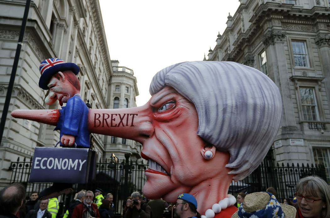 An effigy of British Prime Minister Theresa May passes by Downing Street during a Peoples Vote anti-Brexit march in London, Saturday, March 23, 2019. Anti-Brexit protesters swarmed the streets of ...