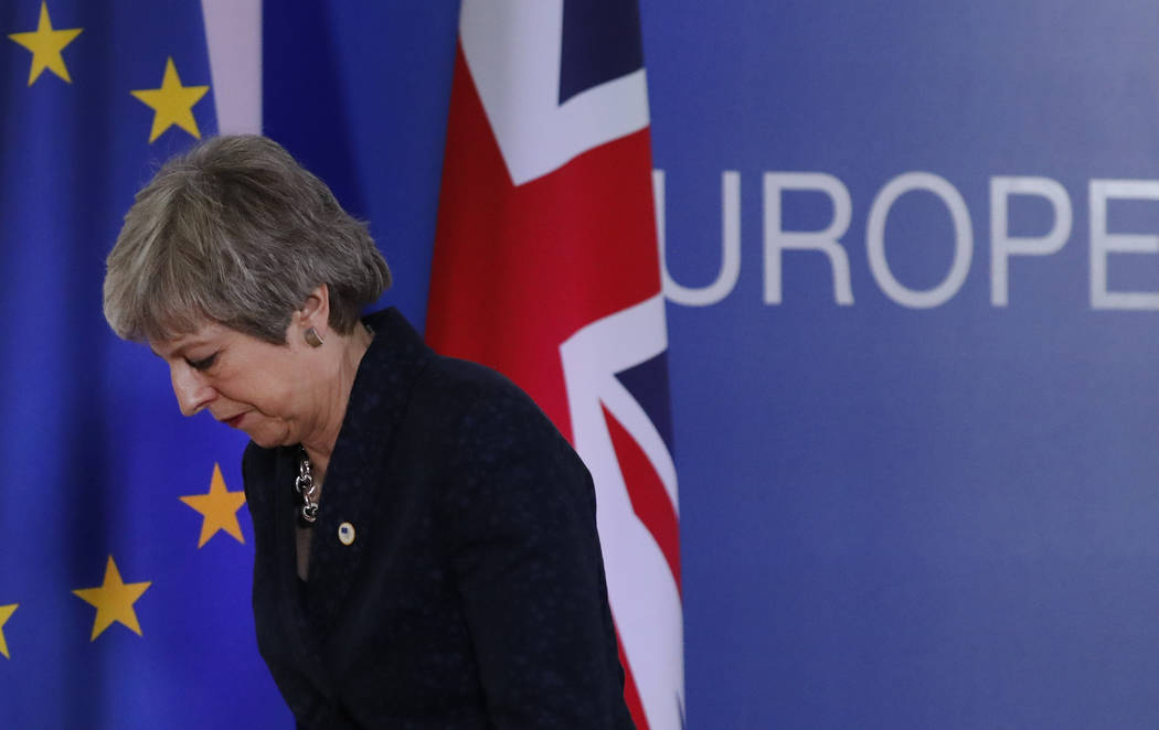 British Prime Minister Theresa May leaves after addressing a media conference at an EU summit in Brussels, Friday, March 22, 2019. Worn down by three years of indecision in London, EU leaders on T ...