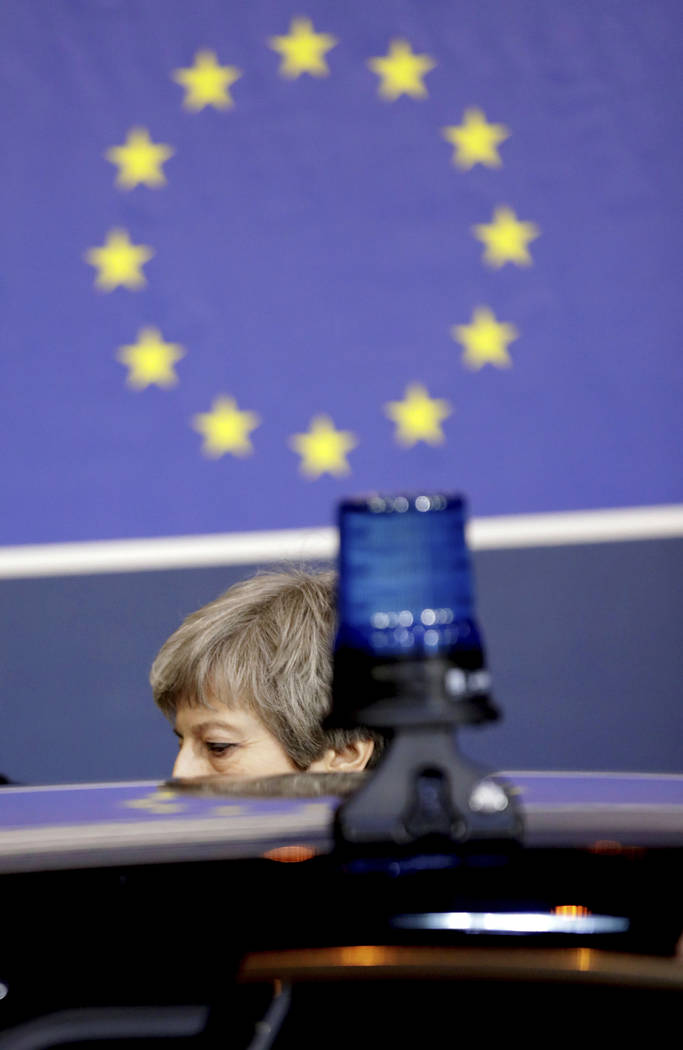 British Prime Minister Theresa May leaves at the end of an EU summit in Brussels, Friday, March 22, 2019. Worn down by three years of indecision in London, EU leaders on Thursday were grudgingly l ...