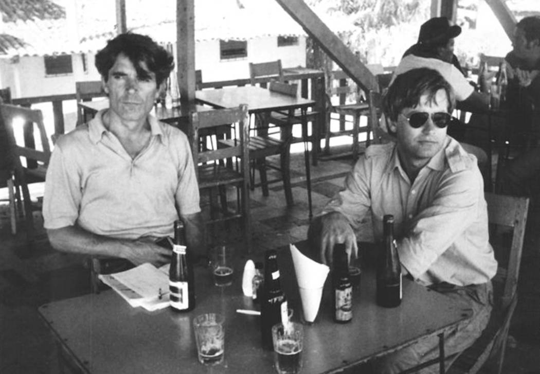 In this undated photo provided by Gert Kuiper, his brother, Jan Kuiper, right, sits with fellow journalist Koos Koster, two of the four journalists killed in El Salvador in 1982. Calls are mountin ...