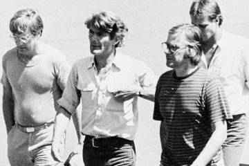 In this March 11, 1982 photo, from left, Jan Cornelius Kuiper, director, Koos Koster, producer, Johannes Willemsen, cameraman, and Hans ter Laan, soundman walk north of the capital, San Salvador, ...