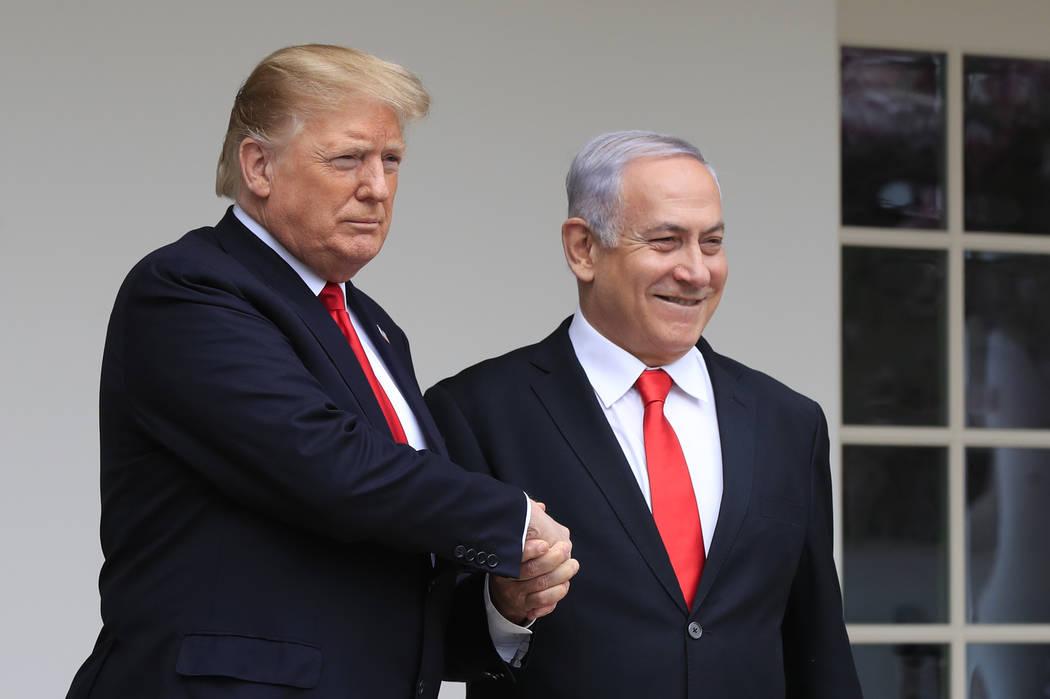 President Donald Trump welcomes visiting Israeli Prime Minister Benjamin Netanyahu to the White House in Washington, Monday, March 25, 2019. (AP Photo/Manuel Balce Ceneta)