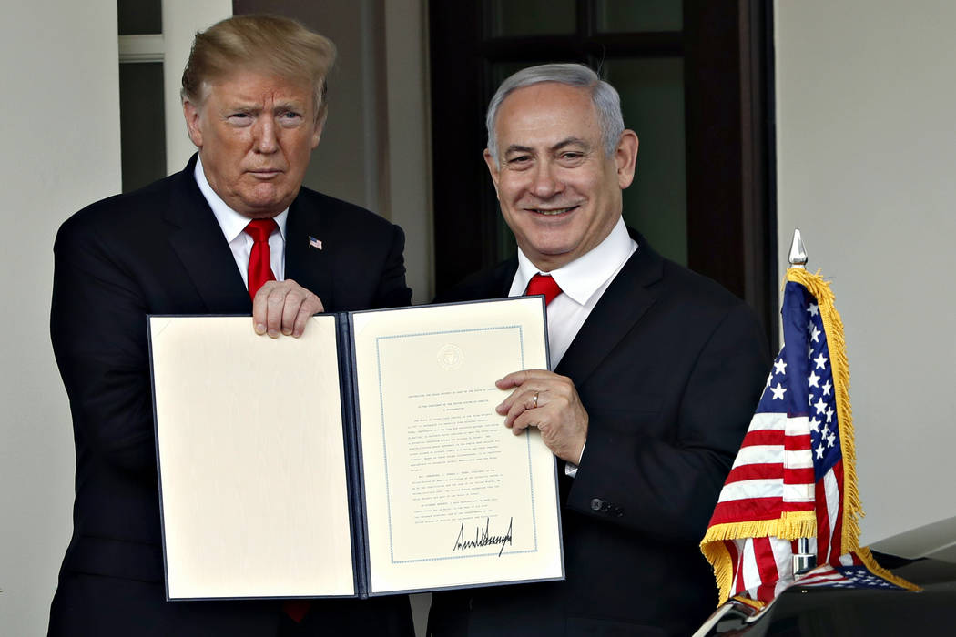 President Donald Trump and Israeli Prime Minister Benjamin Netanyahu hold up a signed proclamation, after their meeting as the Prime Minister leaves the White House, Monday March, 25, 2019, in Was ...