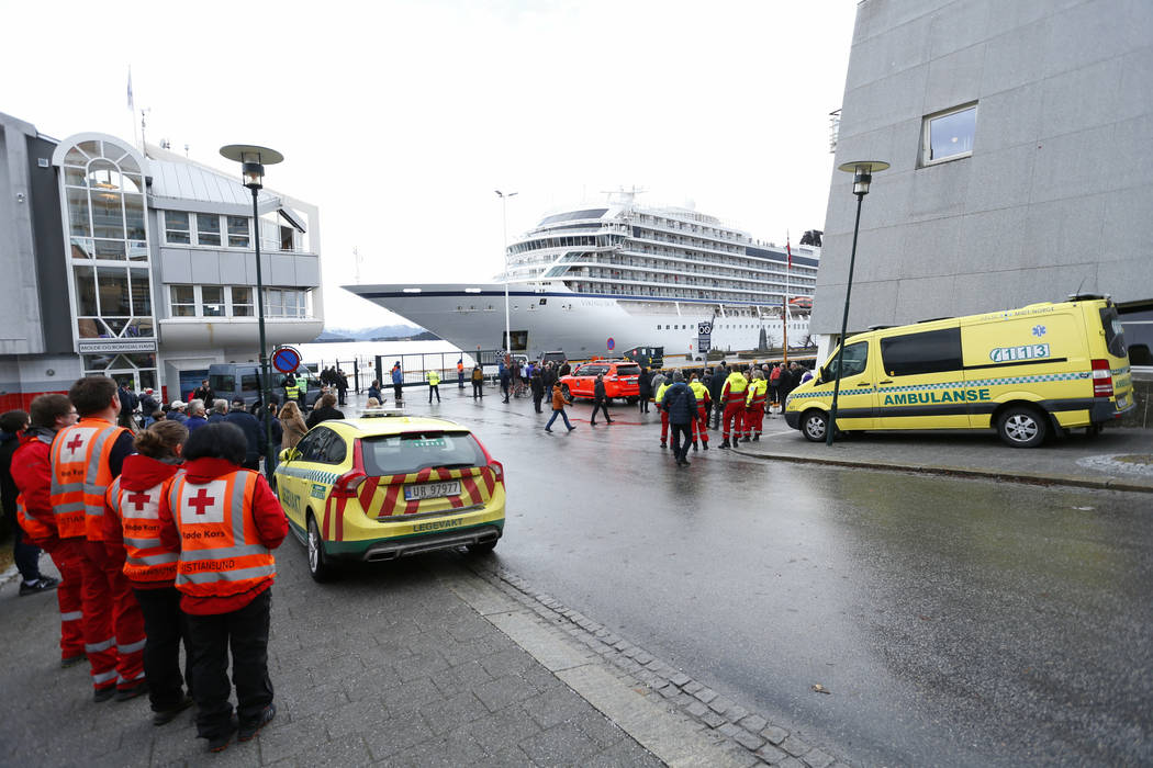 The cruise ship Viking Sky arrives at port in Molde, Norway, Sunday March 24, 2019, after having problems and issuing a Mayday call on Saturday in heavy seas off Norway's western coast. Rescue hel ...