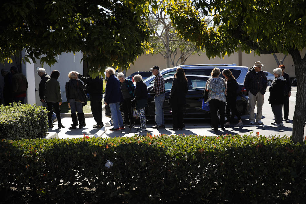 In this Feb. 19, 2019 photo, a group of retired seniors from Laguna Woods Village form a line outside Bud and Bloom cannabis dispensary to attend a presentation organized by cannabis product vendo ...