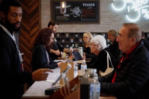 In this Feb. 19, 2019 photo, a group of seniors from Laguna Woods Village consult with sales associates at Bud and Bloom cannabis dispensary in Santa Ana, Calif. The seniors boarded a bus for the ...