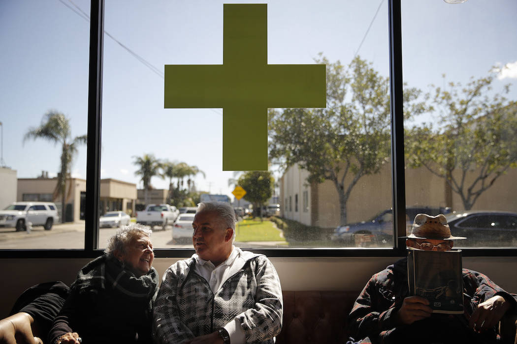 In this Feb. 19, 2019 photo, Kay Nelson, left, and Bryan Grode, retried seniors from Laguna Woods Village, chat in the lobby of Bud and Bloom cannabis dispensary while waiting for a free shuttle t ...