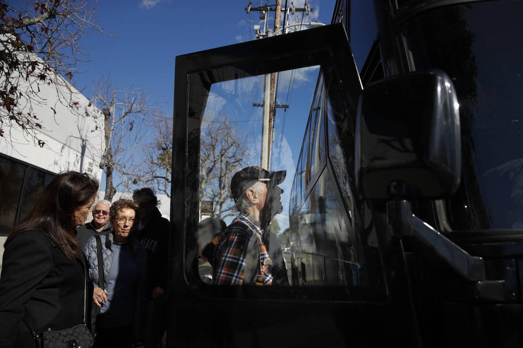 In this Feb. 19, 2019 photo, a group of seniors from Laguna Woods Village board a free shuttle bus back to their retirement community after visiting Bud and Bloom cannabis dispensary in Santa Ana, ...