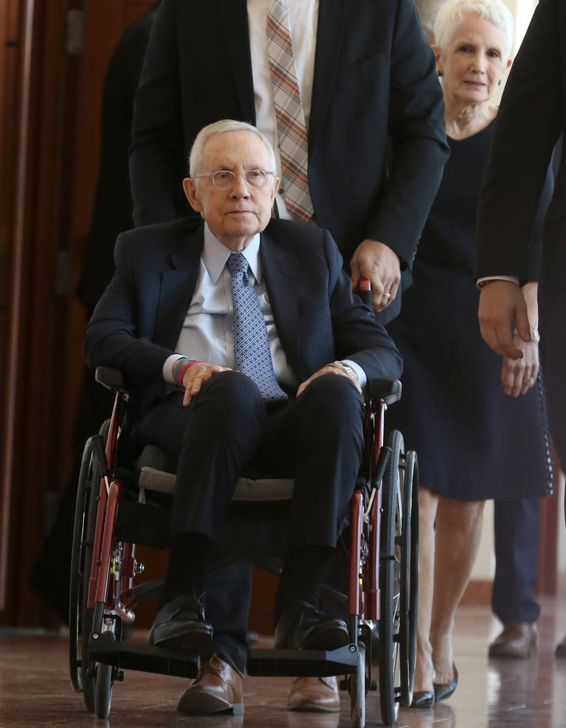Former U.S. Sen. Harry Reid, who sued the makers of an exercise band after injuring his eye, leaves the courtroom with his wife, Landra Gould, second right, after attending the first day of jury s ...