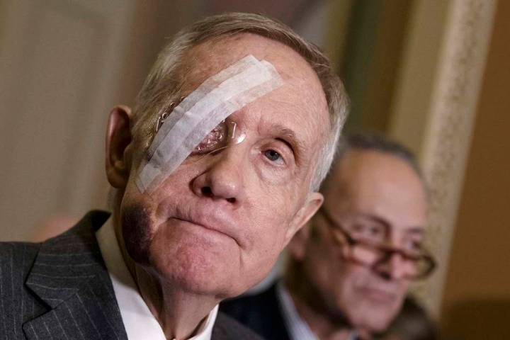 Senate Minority Leader Harry Reid of Nev., joined by Sen. Charles Schumer, D-N.Y., takes questions from reporters during a news conference on Capitol Hill in Washington, Tuesday, Feb. 10, 2015, fo ...