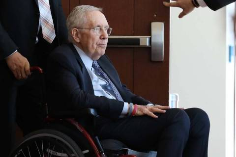 Former U.S. Sen. Harry Reid, who sued the makers of an exercise band after injuring his eye, leaves the courtroom after attending the first day of jury selection in his civil trial at the Regional ...