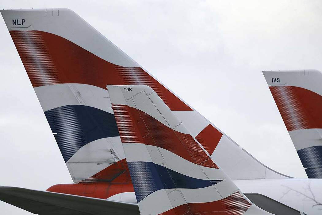 In this file photo dated Tuesday, Jan. 10, 2017, British Airways planes are parked at Heathrow Airport in London. (Frank Augstein/AP file)