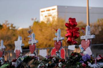 A makeshift memorial is seen Feb. 19, 2018, outside the Marjory Stoneman Douglas High School, where 17 students and faculty were killed in a mass shooting in Parkland, Fla. (AP Photo/Gerald Herber ...