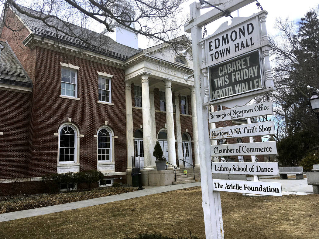 Signs hang outside Edmond Town Hall, a building that houses a community theater and offices, Monday, March 25, 2019, in Newtown, Conn. Jeremy Richman, father of Sandy Hook Elementary school shooti ...