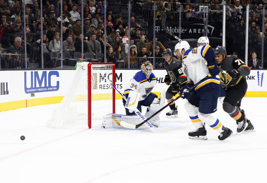 Vegas Golden Knights right wing Ryan Reaves (75) skates towards St. Louis Blues center Tyler Bozak (21) as he goes after the puck during the first period of their NHL game in Las Vegas, Friday, No ...