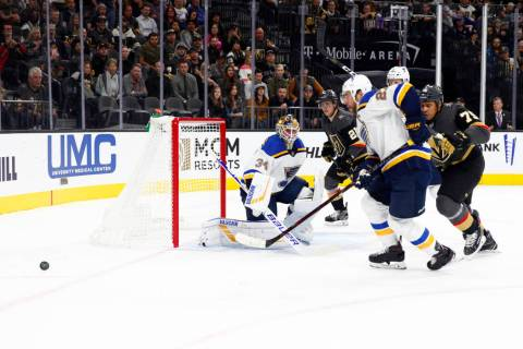 Vegas Golden Knights right wing Ryan Reaves (75) skates toward St. Louis Blues center Tyler Bozak (21) as he goes after the puck during the first period of their NHL game in Las Vegas, Friday, Nov ...