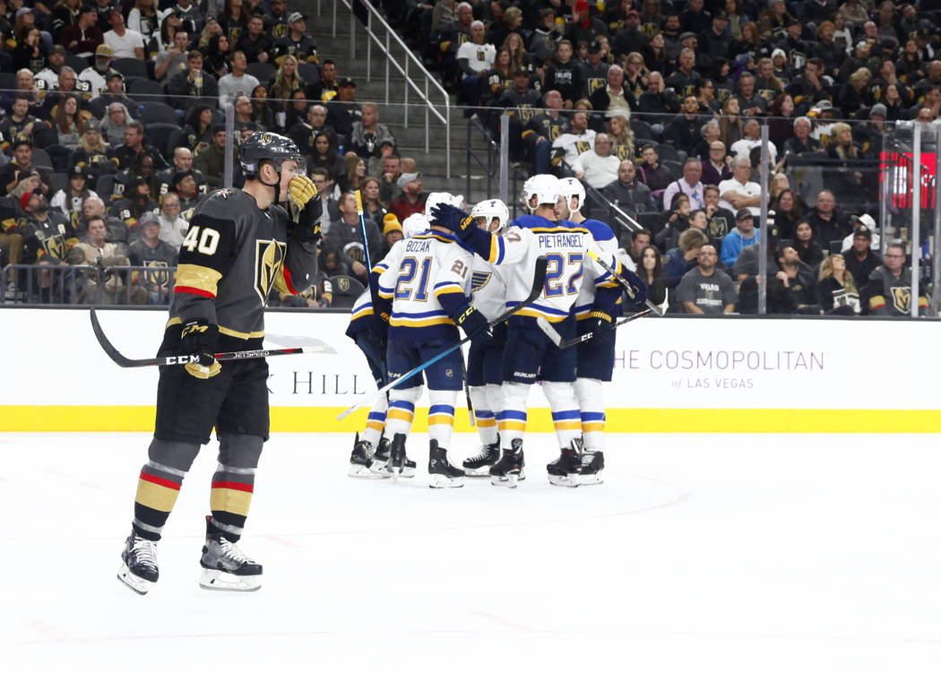 Vegas Golden Knights center Ryan Carpenter (40) skates past the St. Louis Blues players as they celebrate a goal by St. Louis Blues center Brayden Schenn (10), not pictured, during the second peri ...