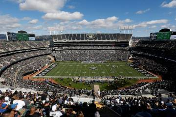 Fans at Oakland Alameda County Coliseum watch from a general view during the first half of an NFL football game between the Oakland Raiders and the Indianapolis Colts in Oakland, Calif., Sunday, O ...