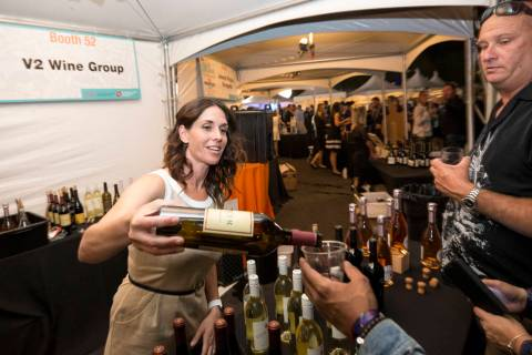 Guest sample wines at the V2 Wine Group booth during the 44th Annual UNLVino fundraiser at the Keep Memory Alive Event Center at Cleveland Clinic Lou Ruvo Center for Brain Health in Las Vegas on S ...