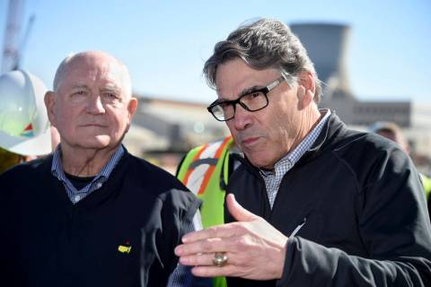 U.S. Secretary of Energy Rick Perry, right, and U.S. Secretary of Agriculture Sonny Perdue answer reporters questions at the Plant Vogtle nuclear energy facility in Waynesboro, Ga., Friday, March ...