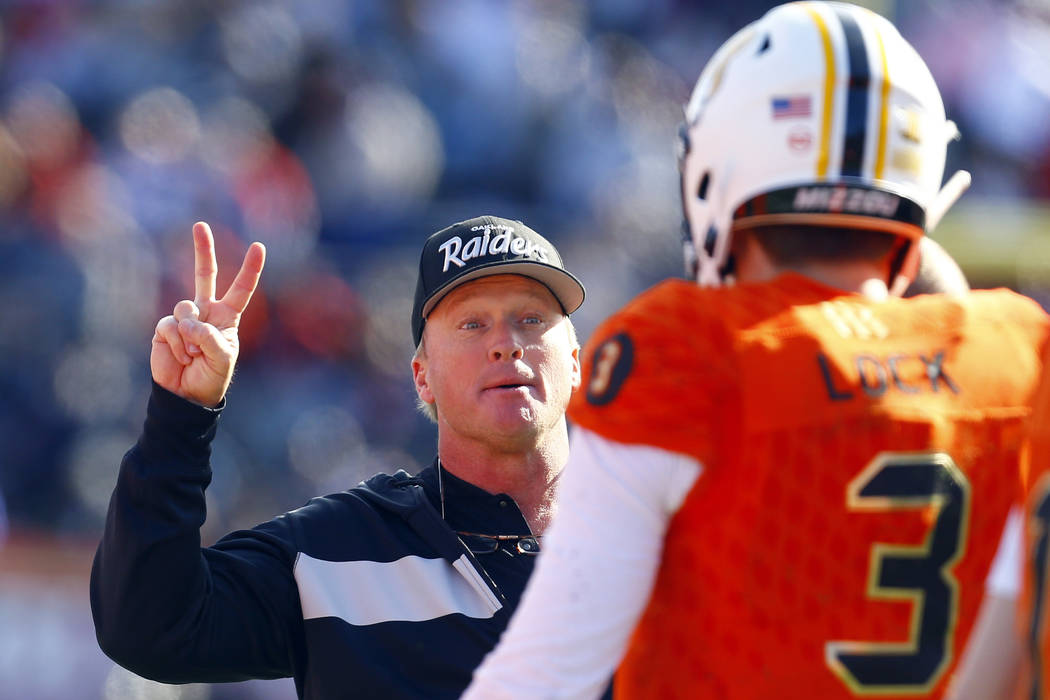North head coach Jon Gruden, of the Oakland Raiders, talks with North quarterback Drew Lock, of Missouri, during the first half of the Senior Bowl college football game, Saturday, Jan. 26, 2019, i ...