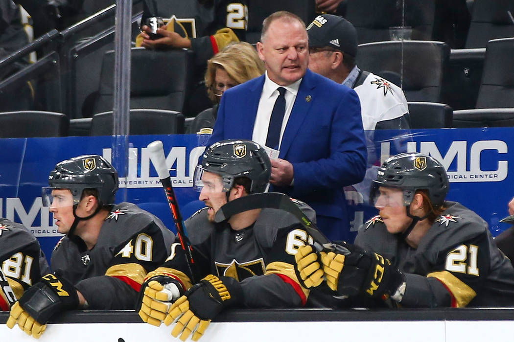 Golden Knights head coach Gerard Gallant, in blue, looks on during the second period of an NHL hockey game against the Winnipeg Jets at T-Mobile Arena in Las Vegas on Thursday, March 21, 2019. (Ch ...
