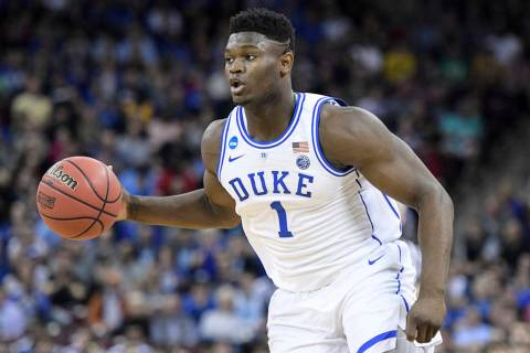 Duke forward Zion Williamson (1) dribbles the ball during the first half of a second-round game in the NCAA men's college basketball tournament Sunday, March 24, 2019, in Columbia, S.C. Duke defea ...