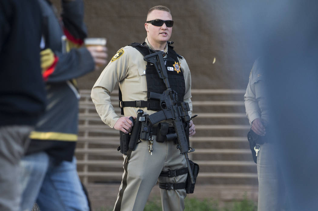 Metro officer Dallin Van Buskirk, armed with an AR-15 semi-automatic rifle with a scope, patrol ...