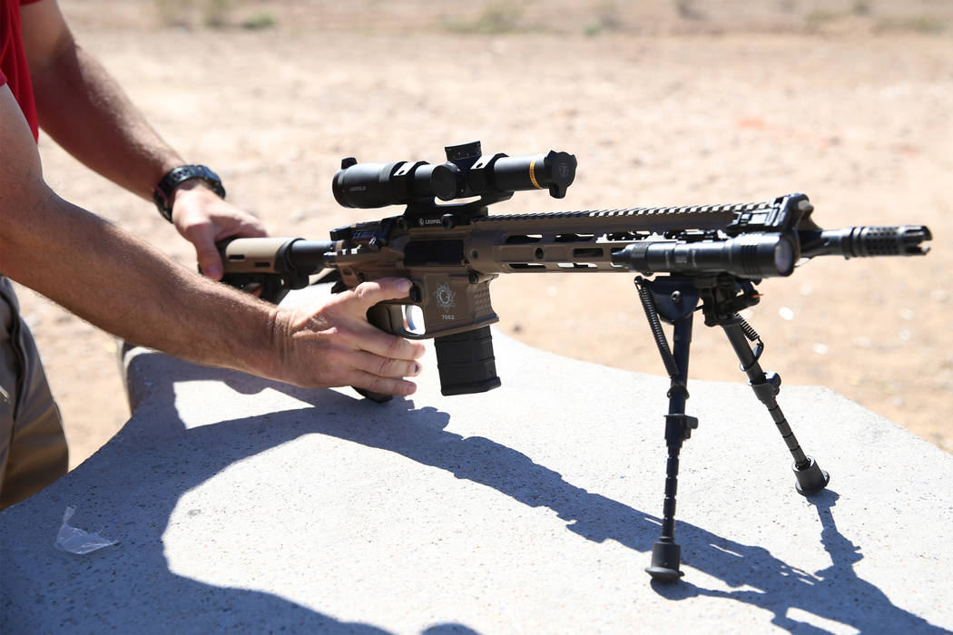 Las Vegas police Sgt. Shawn Romprey prepares to shoot his semi-automatic rifle at the Metropoli ...