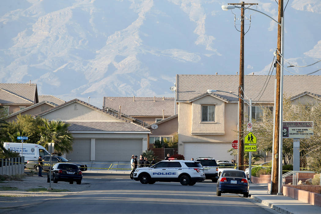 North Las Vegas Police investigate a shooting on San Miguel Avenue near Coleman Street Monday, March 25, 2019. North Las Vegas police said multiple people were injured, with one of the injured run ...