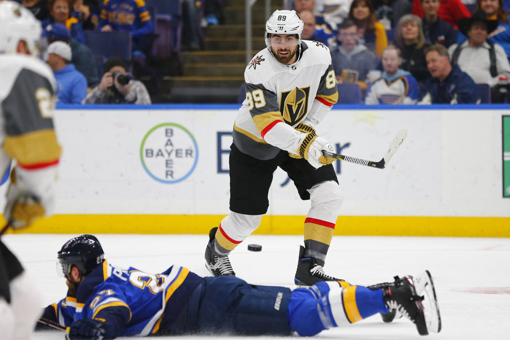 Vegas Golden Knights' Alex Tuch (89) has his pass deflected by St. Louis Blues' Alex Pietrangelo (27) during the first period of an NHL hockey game Monday, March 25, 2019, in St. Louis. (AP Photo/ ...