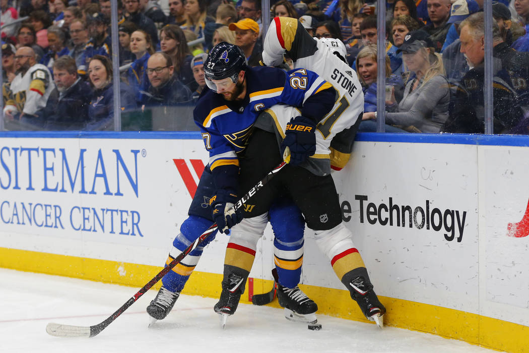 St. Louis Blues' Alex Pietrangelo (27) keeps Vegas Golden Knights' Mark Stone (61) off the puck during the first period of an NHL hockey game Monday, March 25, 2019, in St. Louis. (AP Photo/Dilip ...