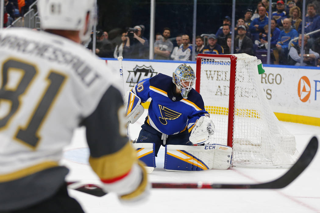 St. Louis Blues' goalie Jordan Binnington (50) makes a save against the Vegas Golden Knights during the first period of an NHL hockey game Monday, March 25, 2019, in St. Louis. (AP Photo/Dilip Vis ...