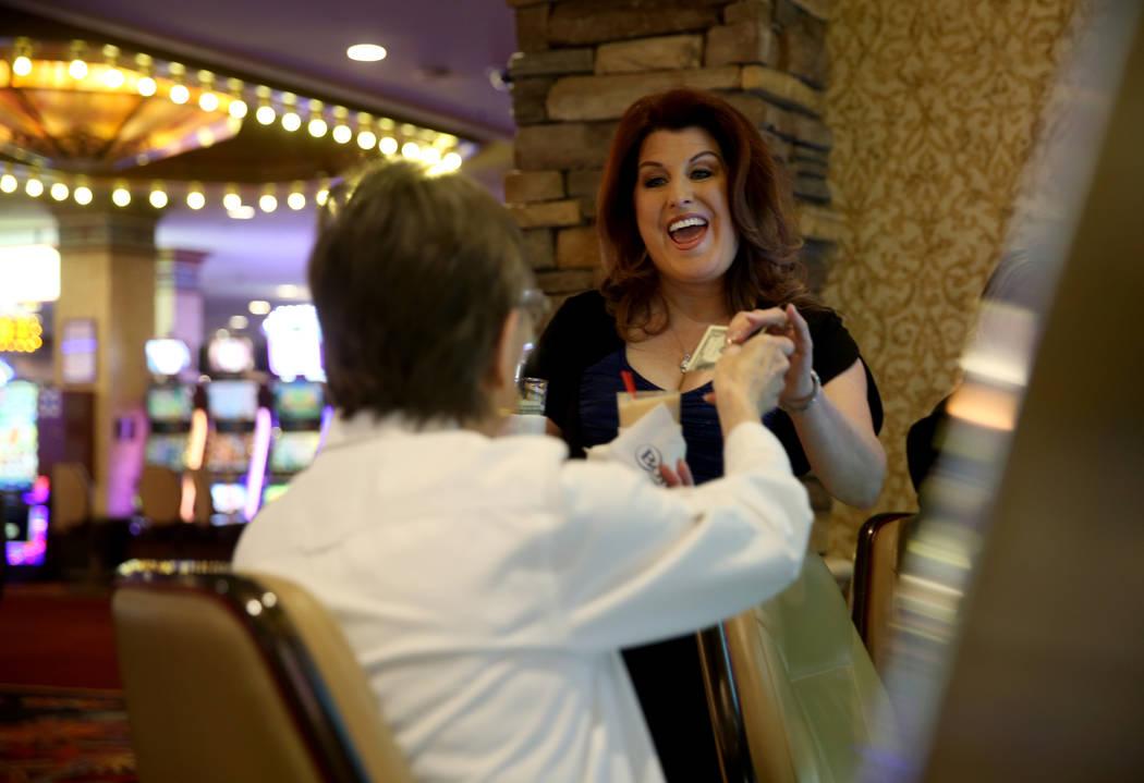 Maryanne Cumberledge, 80, of Las Vegas, left, gets her regular tea at her regular machine from ...