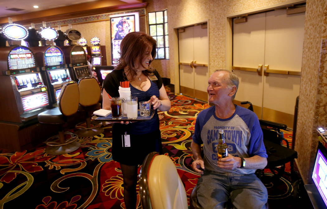 Robert Hansen of Las Vegas gets a drink from server, Ginger Glass-Trotter at Sam's Town Monday, ...