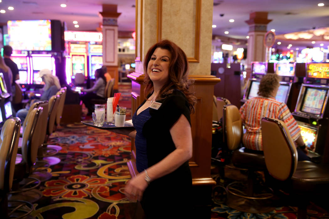 Twenty-five year cocktail server Ginger Glass-Trotter smiles at a customer at Sam's Town Monday ...
