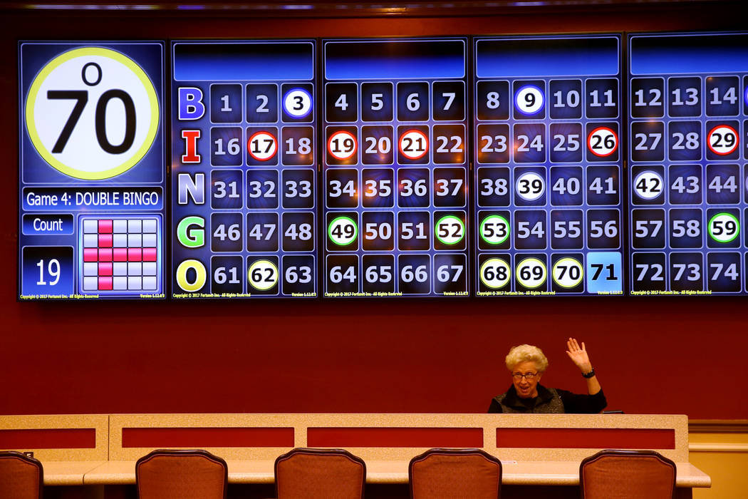Dorothy Henrichsen, of Henderson, who has been a customer for 29 years, gets a bingo during the ...