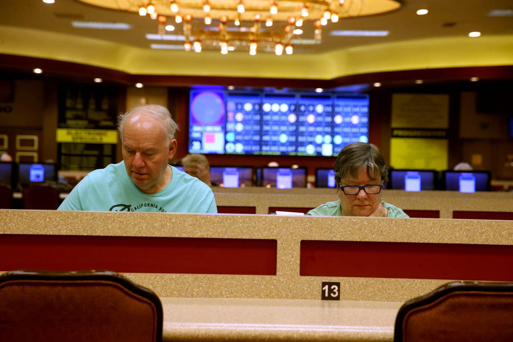 Gregory and Maureen Lemanski, of Toms River, New Jersey, play in the first bingo session of the ...