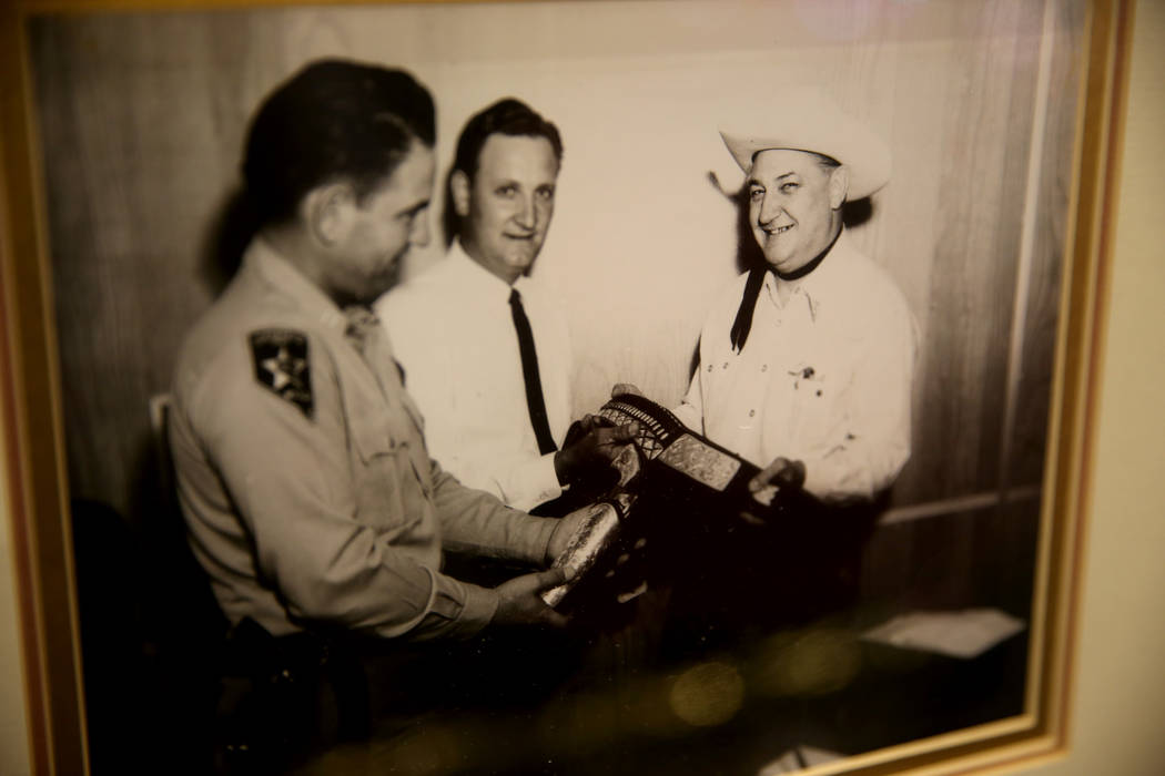 A photo of Boyd Gaming founder Sam Boyd, right, receiving a ceremonial pistol with Sheriff Ralp ...