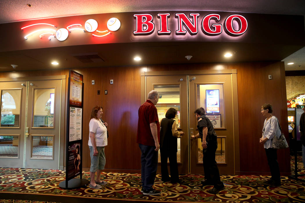 Customers wait for the doors to the bingo room to open at Sam's Town Tuesday, March 26, 2019. ( ...