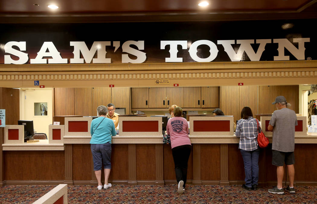 Customers get their buy-ins for the first bingo session of the day at Sam's Town Tuesday, March ...