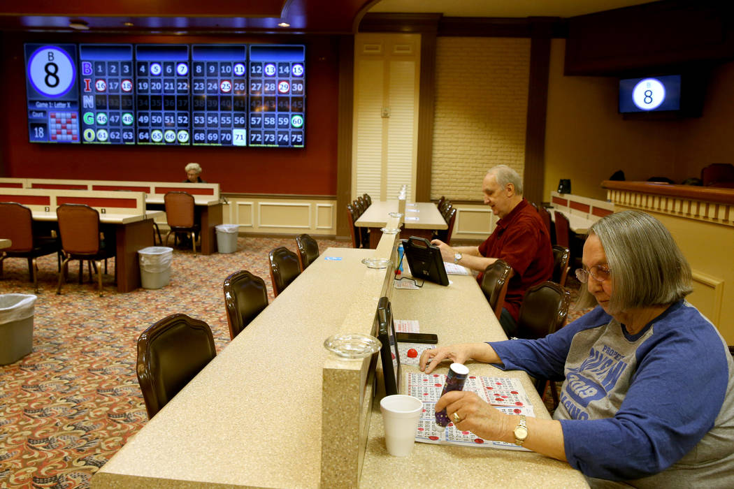 Jon Avery, 72, and his wife Barbara Avery, 70, of Las Vegas, play in the first bingo session of ...