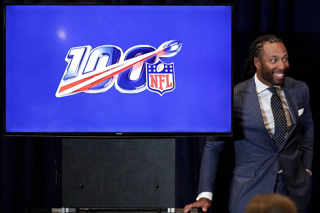 Arizona Cardinals' Larry Fitzgerald listens during a news conference on social justice during the annual NFL football owners meetings, Monday, March 25, 2019, in Phoenix. (AP Photo/Matt York)