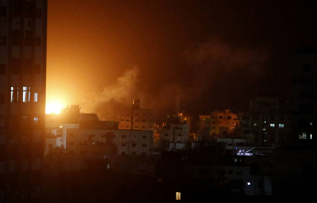 An explosion caused by Israeli airstrikes is seen from Hamas security building in Gaza City, Monday, March 25, 2019. Israeli forces on Monday struck targets across the Gaza Strip in response to a ...