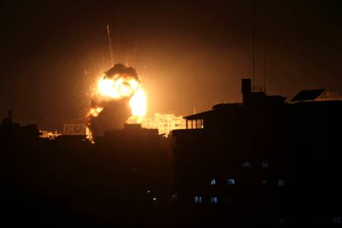 An explosion caused by Israeli airstrikes is seen from the offices of Hamas leader Ismail Haniyeh, in Gaza City, Monday, March 25, 2019. Israeli forces on Monday struck targets across the Gaza Str ...