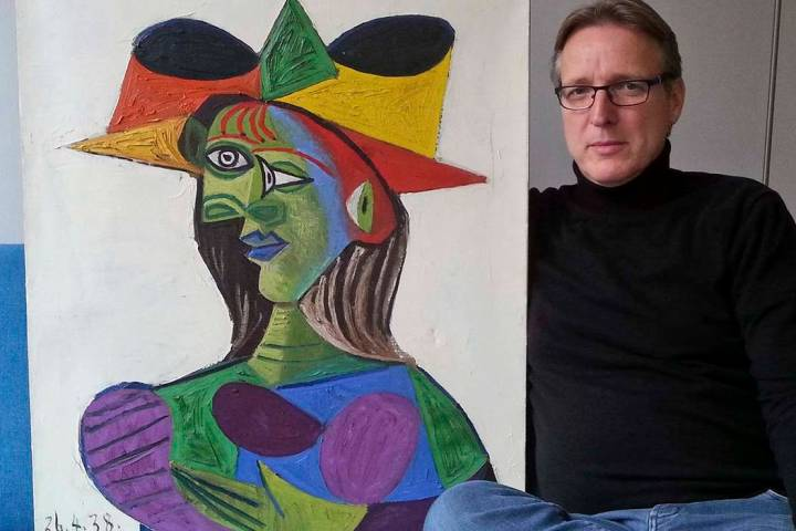 "This image released on Tuesday March 26, 2019, shows Dutch art detective Arthur Brand with ""Buste de Femme"", a recovered Picasso painting. The painting was stolen from a wealthy Saudi's yacht 20 y ..."