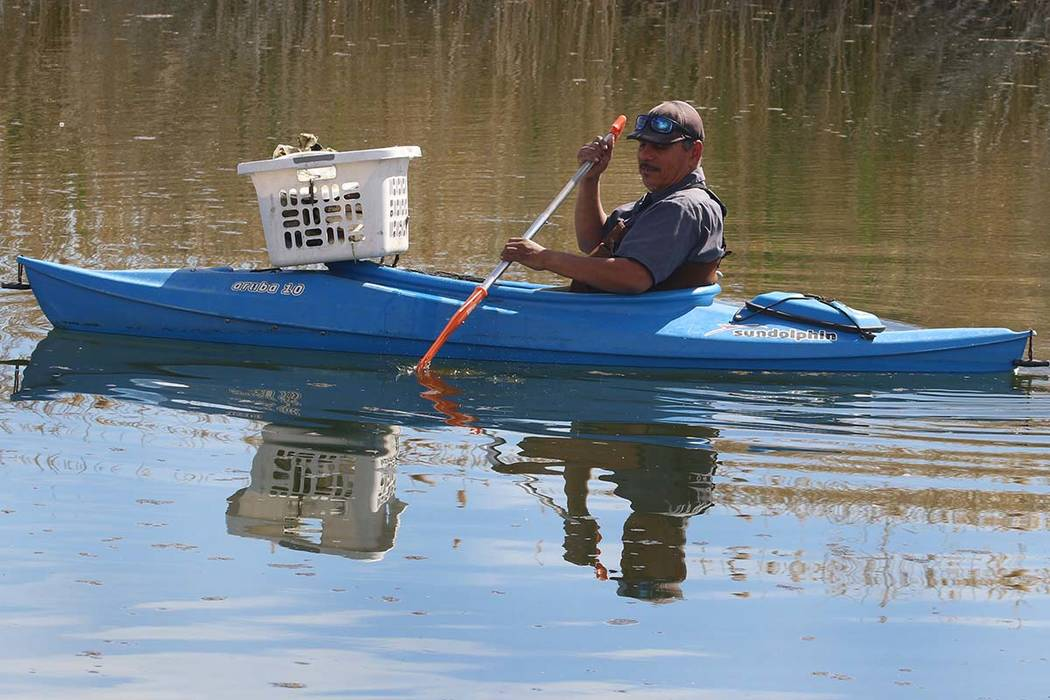 A man, who declined to give his name, kayak as he collects trash from the lake at Cornerstone Park last week in Henderson. The warmest day of 2019 so far in the Las Vegas Valley is expected Tuesda ...