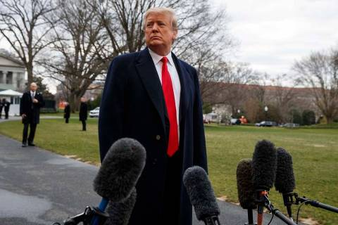 President Donald Trump listens to a question as he speaks with reporters before boarding Marine One on the South Lawn of the White House, Friday, March 22, 2019, in Washington. (AP Photo/Evan Vucci)
