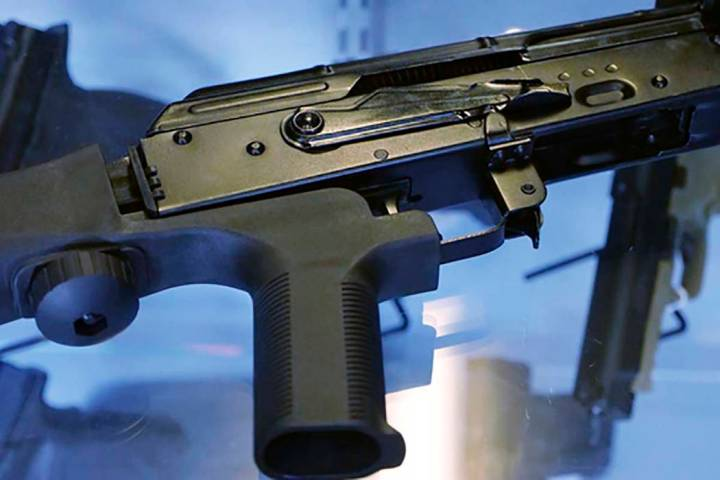 """This Oct. 4, 2017 file photo, shows a """"bump stock"""" attached to a semi-automatic rifle at a gun store and shooting range in Utah. (Rick Bowmer/AP File)"""
