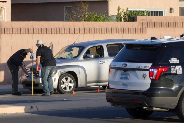 Law enforcement investigate a car accident at South Fort Apache Road and West Arby Avenue that left one minor dead and one hospitalized on Monday, March 25, 2019, in Las Vegas. (Benjamin Hager Rev ...